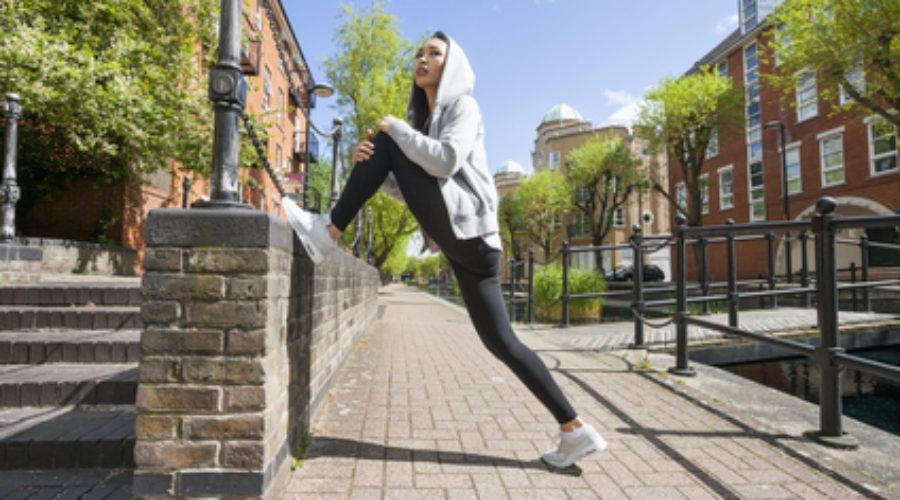 stretching on sidewalk